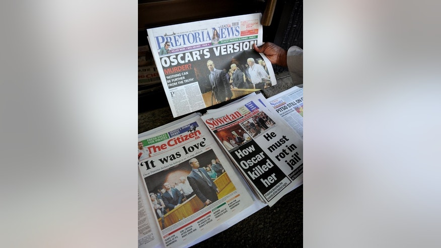 This file photo shows front pages of South African newspapers, featuring Olympic sprinter Oscar Pistorius' February 19 court appearance, displayed on February 20, 2013, outside the Magistrate Court in Pretoria.