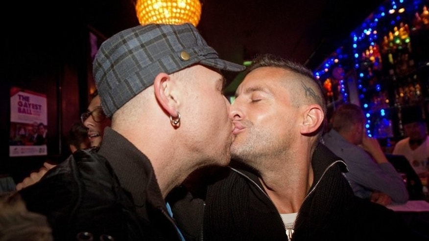 Gay-rights supporters kiss to celebrate at the S&M bar in Wellington on April 17, 2013 after New Zealand became the first Asia-Pacific country to announce it would legalise same-sex marriage. More than 30 couples will tie the knot on Monday.