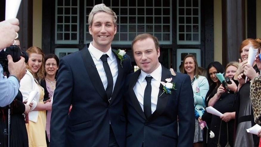 Richard Rawstorn and Richard Andrew celebrate after being married in New Zealand on August 19, 2013. The country is the first Asia Pacific nation to allow same-sex marriage.