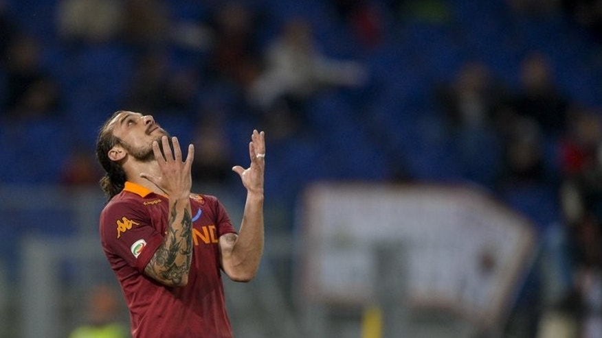 AS Roma's Pablo Osvaldo reacts on May 7 , 2013 at Rome's Olympic stadium. Southampton broke their club record transfer fee on Sunday when they paid Roma ??15 million (17.6 million euros) for striker Osvaldo.