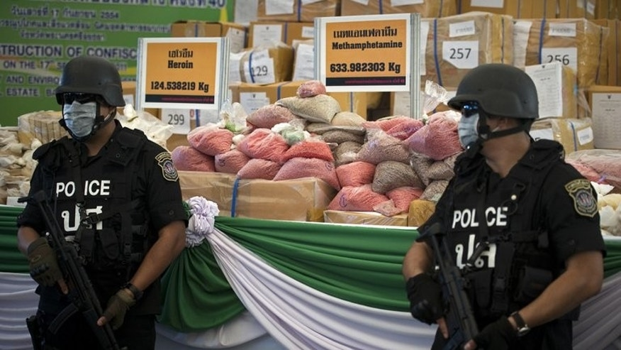 Illustration: Thai police guard bags of methamphetamine pills seized on September 17, 2011. The authorities have seized another 980,000 of the pills, worth $6 million.