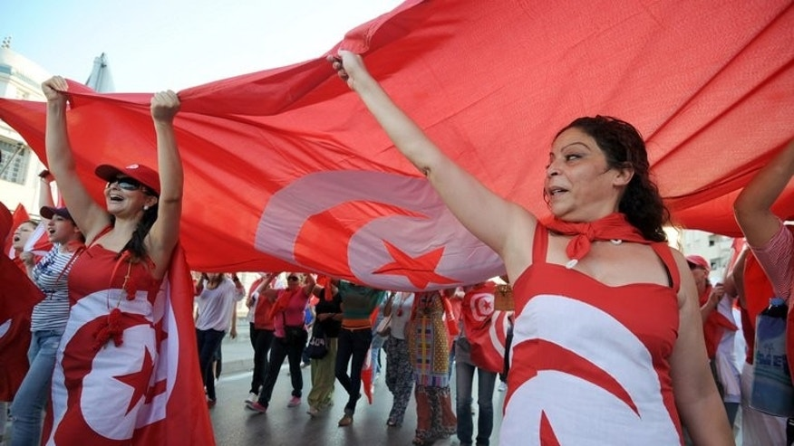 Tunisian demonstrators, bearing the colours of their national flag, shout slogans during a protest against the country's Islamist-led government in front of the Constituent Assembly headquarters in Tunis on August 13, 2013. Ruling Islamist movement Ennahda and the opposition Nidaa Tounes said Sunday they have held secret talks in Europe to try to find a way out of Tunisia's political crisis.
