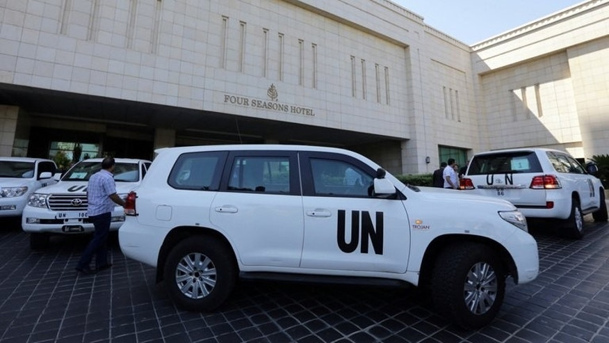 The UN chemical weapons investigation team arrives in Damascus on August 18, 2013. UN inspectors tasked with investigating whether chemical weapons have been used in the Syrian conflict arrived in Damascus on Sunday, an AFP journalist reported.
