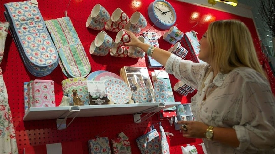 Kitchenware products are put on show at the Cath Kidston head office in London on August 14, 2013. The world of Cath Kidston is instantly identifiable, full of bright colours, cheerful prints and nostalgia for an imagined English way of life -- and has made the homeware company one of Britain's global success stories.