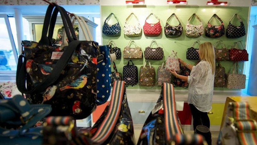 Bags are put on show at the Cath Kidston head office in London on August 14, 2013. A cult following for the vintage-themed bags, clothes and kitchenware, particularly in Asia, helped the company break through the ??100 million ($155 million, 117 million euro) sales barrier this year for the first time.
