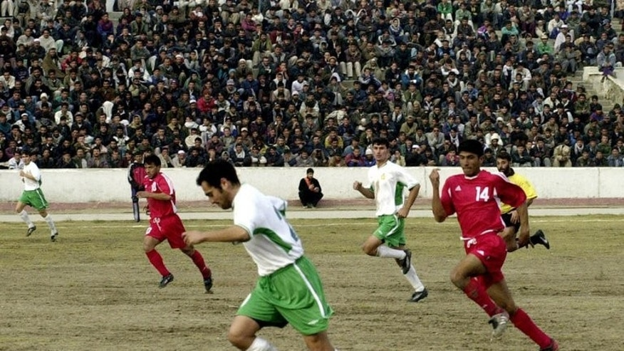 Image taken on November 23, 2003 shows an international football match between Turkmenistan (white tops) and Afghanistan in Kabul. Afghanistan's action-starved football fans are predicting a morale-boosting victory for the national side in their first home game for 10 years when they take on Pakistan on Tuesday.