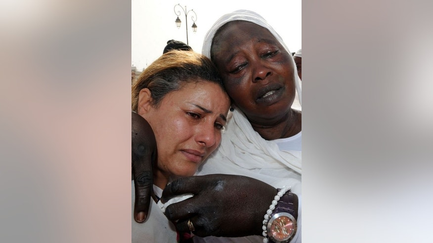 Women mourn the death of a Senegalese man who was killed in a stabbing attack by a Moroccan man on a bus in Rabat, during his funeral procession in the Moroccan capital on August 19, 2013.