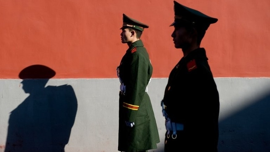 Members of the Chinese police stand guard in Beijing on November 17, 2009. Eight Chinese policemen were sacked Monday after their naked swim at a tourist venue made waves online