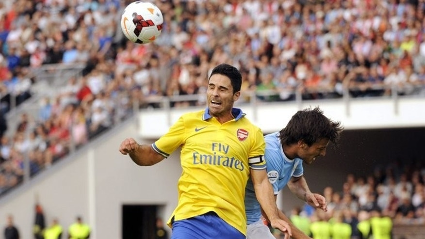 Mikel Arteta (left) beats Manchester City's David Silva to the ball in Helsinki on August 10. Arteta, along with Thomas Vermaelen, Nacho Monreal and Abou Diaby, definitely will miss Arsenal's Champions League qualifier against Fenerbahce on Wednesday through injury.