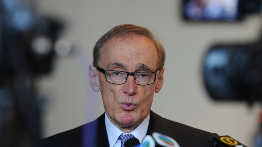 Australia's Foreign Minister Bob Carr speaks to the press after a luncheon in Hong Kong on July 26, 2013. Australian ministers will take part in regional talks in Indonesia on people-smuggling Tuesday in a fresh bid to tackle an issue that looms large at upcoming elections.