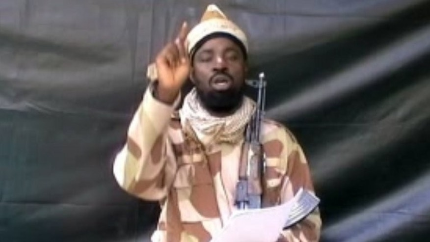 A grab made on July 13, 2013 from a video obtained by AFP shows the leader of the Islamist extremist group Boko Haram Abubakar Shekau, dressed in camouflage and holding an Kalashnikov AK-47. Nigeria's army said Monday that Shekau may have died following a gunshot wound from a clash with soldiers.