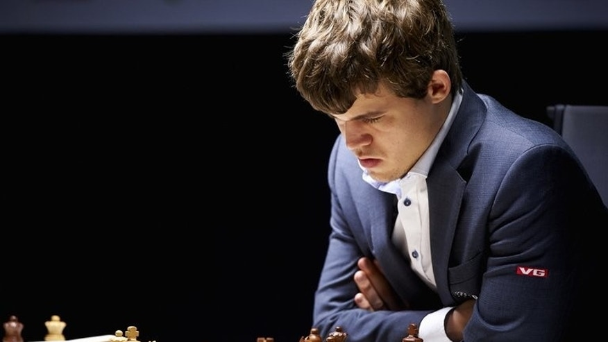 "Norwegian chess player Magnus Carlsen, pictured during the last round of the tournament Norway Chess, in Stavanger, on May 18, 2013. Carlsen has inserted an ""illness clause"" in his contract to play a world championship match in India due to fears of falling sick."