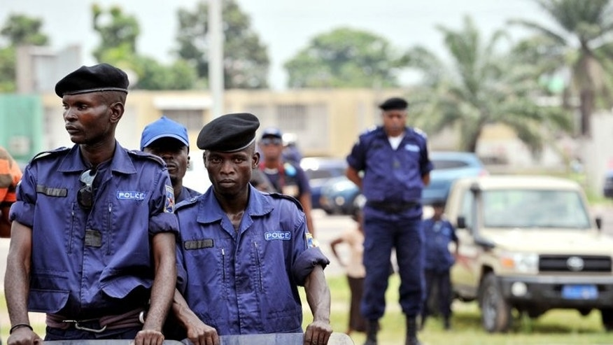 Police officers stand guard in Kinshasa on February 16, 2013. Officials in the Democratic Republic of Congo are probing the death of a Norwegian prisoner in a case of suspected murder or suicide