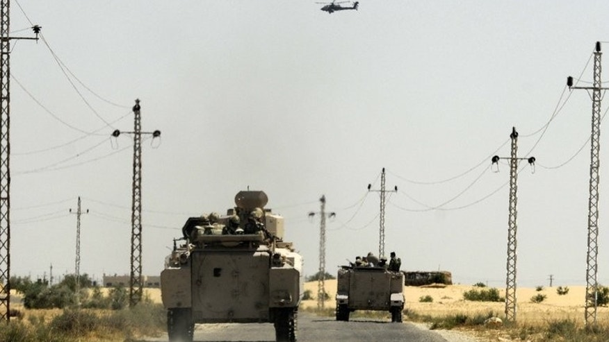 File picture shows Egyptian soldiers and a military helicopter near the Rafah border crossing wiht the Palestinian Gaza Strip on May 21, 2013. Egypt closed its Rafah border crossing in Sinai on Monday after a deadly attack nearby that killed 24 policeman, a border official told AFP.