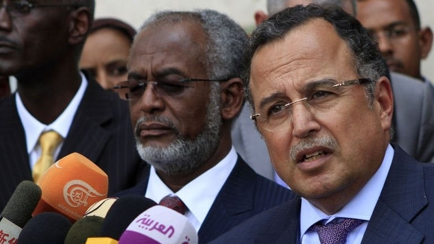"""Egyptian Foreign Minister Nabil Fahmy (R) stands next to his Sudanese counterpart Ali Karti (C) as they address the press in Khartoum on August 19, 2013. Egypt is on the """"right path"""", Fahmy said Monday in Sudan on his first trip abroad, after hundreds died in clashes between Egyptian Islamists and security forces."""