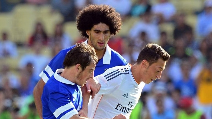 Marouane Fellaini (top) and Leighton Baines tackle Real Madrid's Mezut Ozil in Los Angeles on August 3. Everton have turned down a joint bid from Manchester United for Belgium midfielder Marouane Fellaini and England defender Leighton Baines, according to reports on Monday.
