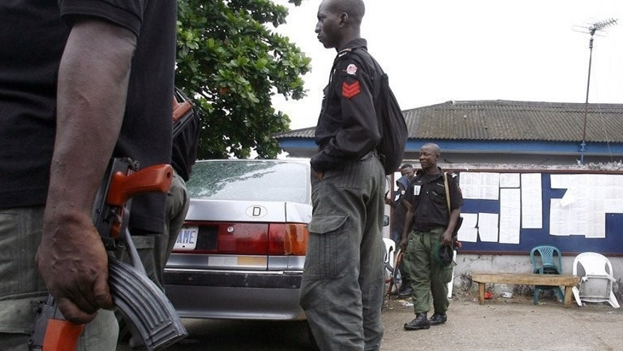 "Nigerian policemen patrol in Lagos on April 22, 2007. Nigerian police have arrested two fake doctors accused of causing the deaths of ""many"" women during childbirth or surgery at a clinic they ran for three years."