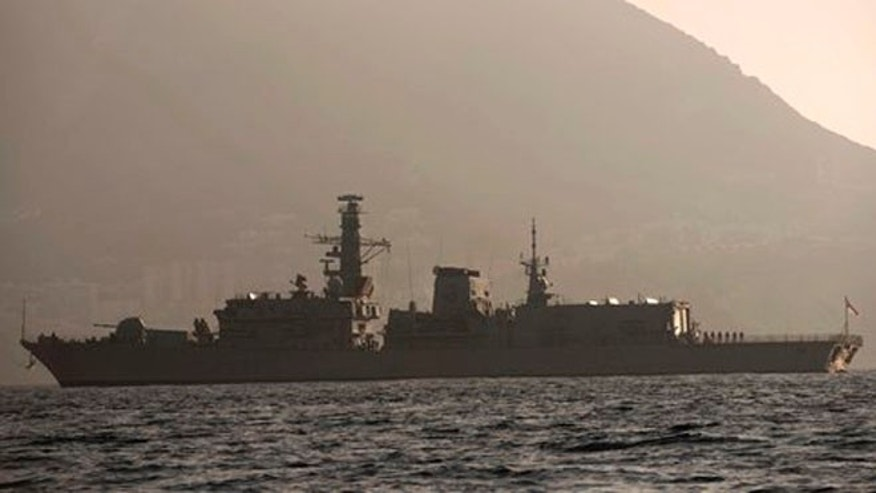 With the rock of Gibraltar in the background, Britain's Royal Navy ship HMS Westminster sails along the Gibraltar stretch near to La Linea de la Concepcion, Spain, Monday, Aug. 19, 2013.