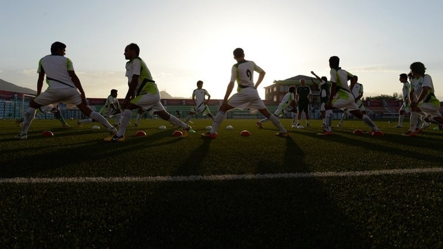 Pakistan football players train at the Afghanistan Football Federation (AFF) stadium in Kabul on August 19, 2013.