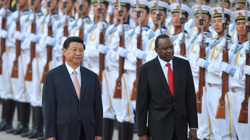 Kenya's President Uhuru Kenyatta (right) and Chinese President Xi Jinping inspect Chinese honour guards during a welcoming ceremony in Beijing on August 19, 2013. Kenyatta, who faces trial on charges of crimes against humanity, was welcomed to China with a 21-gun salute and a meeting with Xi.