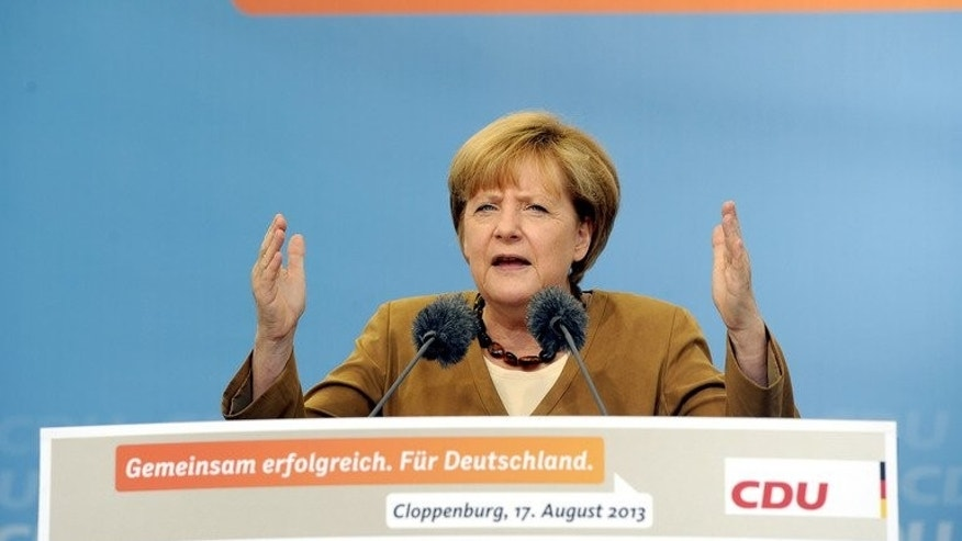 German Chancellor Angela Merkel gives a speech during a pre-election campaign in Cloppenburg, northwestern Germany, on August 17, 2013. Merkel on Tuesday will become the first German chancellor to visit the former Nazi concentration camp Dachau as she steps up warnings about the far-right threat while campaigning for a third term.