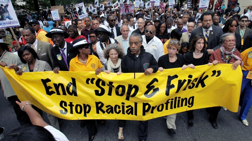 "In this June 17, 2012, file photograph, the Rev. Al Sharpton, center, walks with demonstrators during a silent march to end New York's ""stop-and-frisk"" program. (AP Photo/Seth Wenig, File)"
