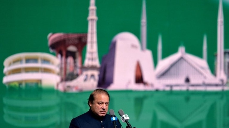 Pakistani Prime Minister Nawaz Sharif speaks in Islamabad on August 14, 2013. Sharif on Monday called for dialogue with extremists in order to end bloodshed that has left thousands dead in the country over the past decade.