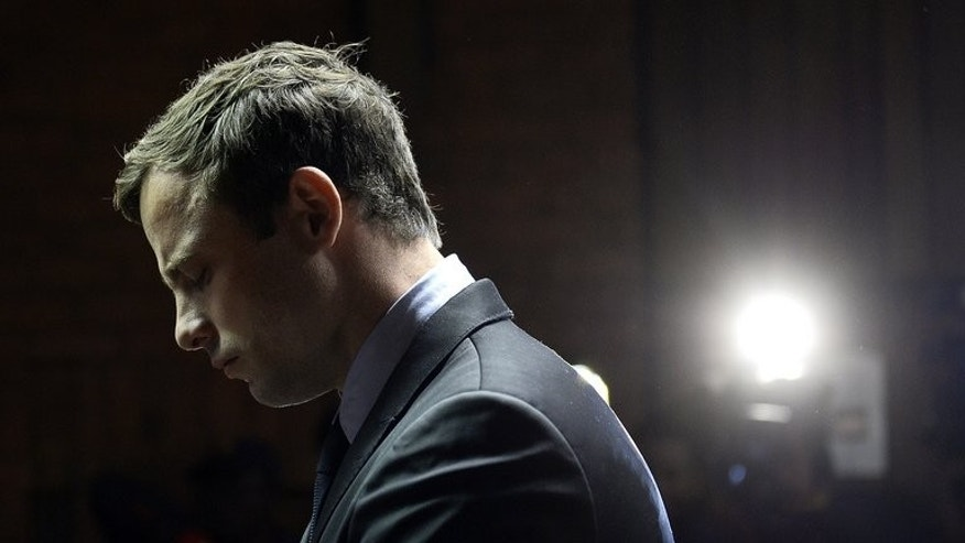 South African Paralympic sprinter Oscar Pistorius appears at the Magistrate Court in Pretoria on August 19, 2013. Olympic hero Pistorius was publicly adored, but the killing of his girlfriend has exposed a private life filled with rash behaviour, guns, beautiful women and fast cars.