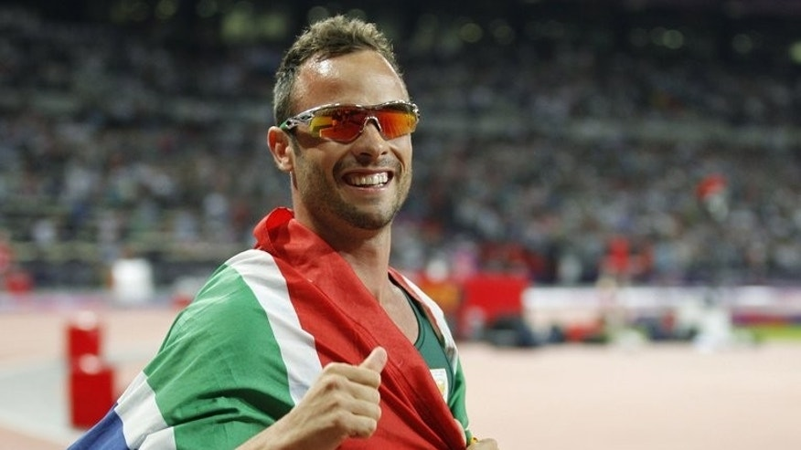 South Africa's Oscar Pistorius celebrates winning gold at the London 2012 Paralympic Games on September 8, 2012.
