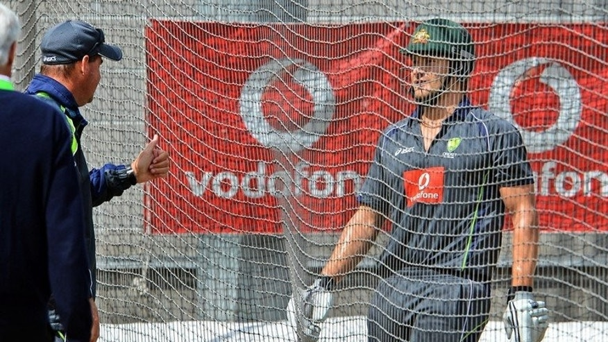 Australian team coach Mickey Arthur gestures to vice-captain Shane Watson on December 25, 2012. Since-sacked Arthur has described the Australian outfit as an 'old boys' club' where many ex-players wield influence over team decisions.