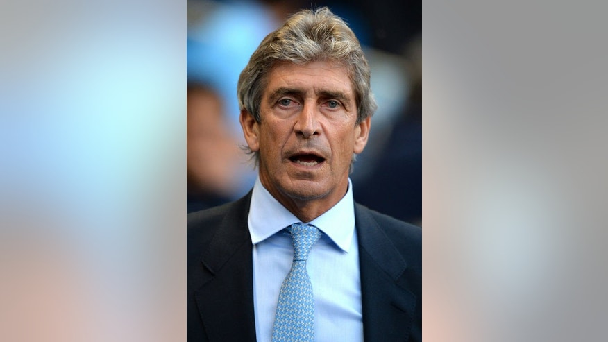 Manchester City's manager Manuel Pellegrini attends the English Premier League football match between Manchester City and Newcastle United at The Etihad stadium in Manchester, northwest England, on August 19, 2013. City won 4-0.