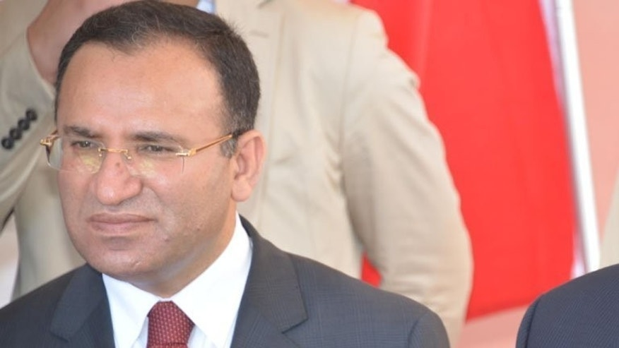 File picture shows Turkish deputy prime minister Bekir Bozdag giving a press conference in Mogadishu on February 23, 2013. Bozdag on Monday accused the Organisation of Islamic Cooperation (OIC) and its Turkish secretary general of remaining indifferent to the bloodshed in Egypt.