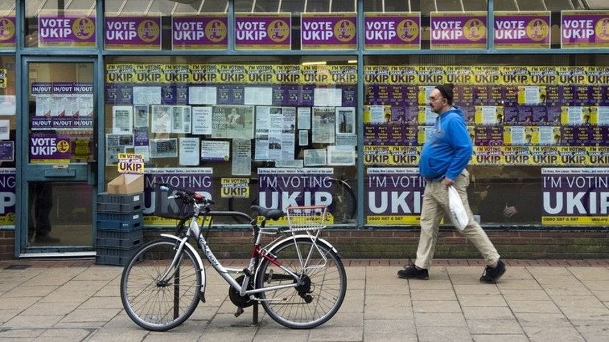 "This file photo shows a man walking past the British UK Independence Party (UKIP) office in Eastleigh, southern England, on February 25, 2013. The chief executive of UKIP has resigned by ""mutual agreement"" after less than a year in the job, the party confirmed on Monday."