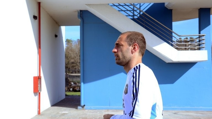 Argentina's defender Pablo Zabaleta leaves the AFA's training camp near Ezeiza after a training session on June 4, 2013. Manchester City's Zabaleta signed a new four-year contract just hours before his team's opening Premier League fixture on Monday.