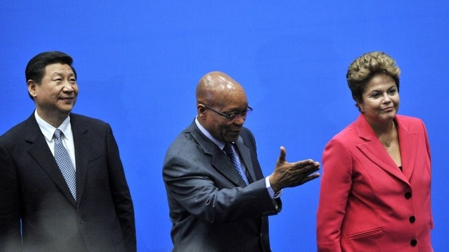 BRICS leaders, President of the People???s Republic of China Xi Jinping, South Africa's President Jacob Zuma, and Brazil's President Dilma Rousseff, arrive in Durban on March 27, 2013. Business leaders from the BRICS group of emerging economies met Tuesday to discuss trade with Africa, insisting that the bloc's planned development bank has not been abandoned.