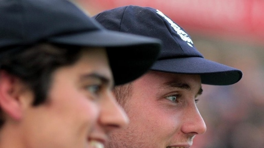 England's captain Alastair Cook (L) and Stuart Broad speak to media after England won their fourth Ashes Test match against Australia, at Durham cricket ground in north-east England, on August 12, 2013.