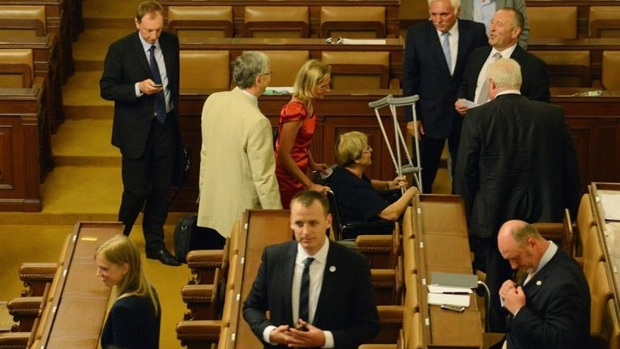 Czech lawmakers leave Parliament on August 20, 2013 in Prague after voting to dissolve the Parliament. Czech lawmakers voted to dissolve parliament on Tuesday, triggering early elections that could put an end to months of political turmoil over a spy and bribery scandal.