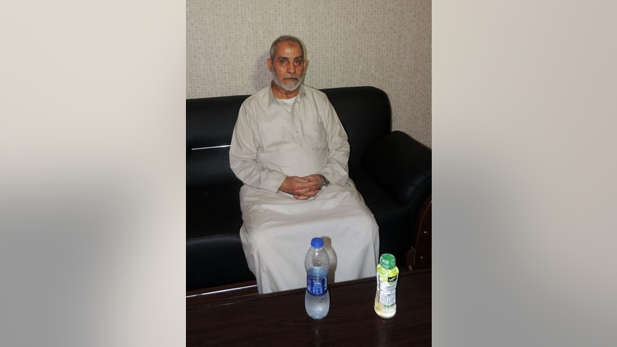 A picture distributed by the Egyptian interior ministry shows Mohamed Badie, the supreme guide of the Muslim Brotherhood, following his arrest in the early hours of August 20, 2013 in Cairo's Nasr City district.