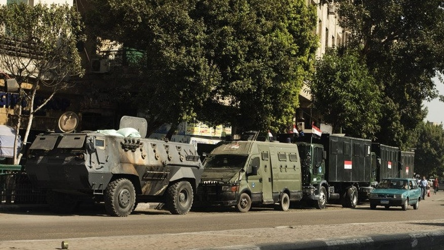 Egyptian riot police vehicles are parked in the main street leading to Egypt's landmark Tahrir square on August 20, 2013 in Cairo. Egypt's interim prime minister said Tuesday his country could live without aid from the United States as Washington and the EU review ties with Cairo amid a bloody crackdown on supporters of deposed president Mohamed Morsi.