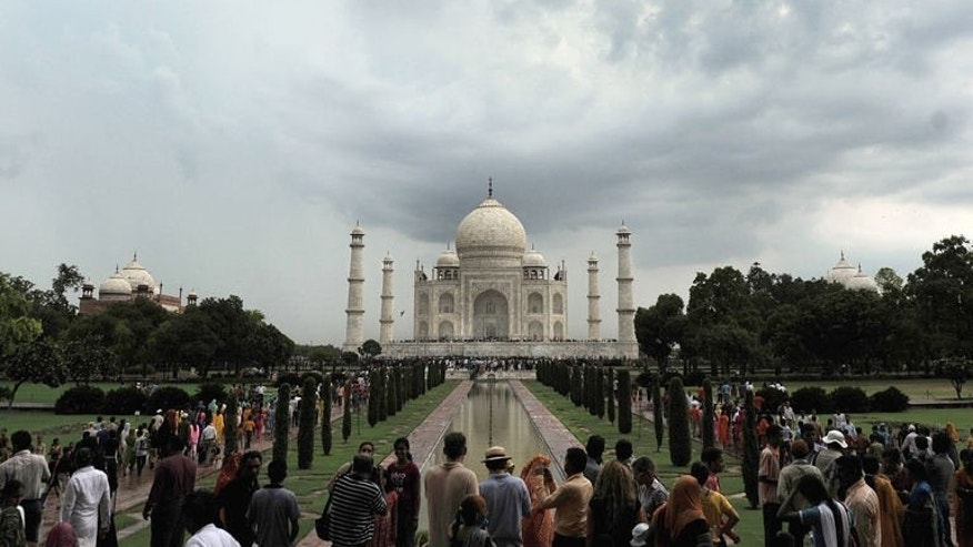 The Taj Mahal in Agra on July 21, 2009. India's monument to love, the Taj Mahal, was once even more romantic, cloaked behind towering foliage and only shyly revealing its contours as the visitor approached -- until a British viceroy removed the mystery.
