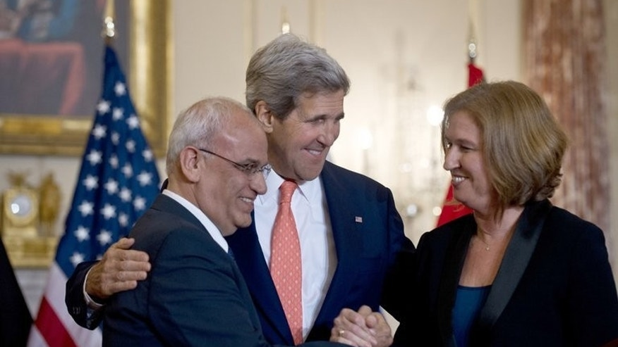 US Secretary of State John Kerry (C) looks on as chief Palestinian negotiator Saeb Erakat (L) and Israel's Justice Minister Tzipi Livni shake hands after speaking at the State Department in Washington on July 30, 2013. Israeli and Palestinian negotiators met secretly in Jerusalem on Tuesday, a senior Palestinian official said, a week after US-brokered peace talks were relaunched in the Holy City.