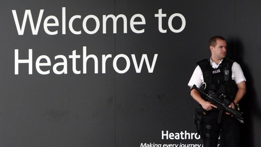 A police officer stands guard at Heathrow airport on June 30, 2011. The law under which British police detained David Miranda, the partner of US journalist Glenn Greenwald, gives broad powers to officials at ports and borders to question those they suspect of terrorism.