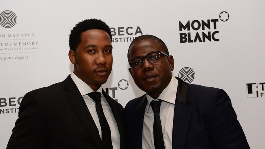 "South African president Nelson Mandela's grandsons, Kweku Mandela (R) and Ndaba Mandela arrive at a party for ""Power of Words: Nelson Mandela"" at the 2013 Tribeca Film Festival in New York, April 19, 2013. Nelson Mandela has countless streets named after him, his own foundation, his own fan page and now his own social network."