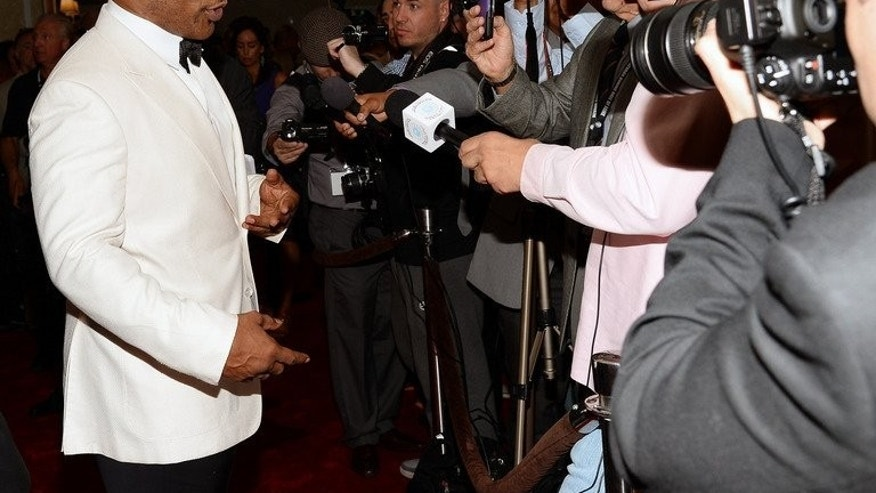 "Mike Tyson is interviewed as he arrives at the Nevada Boxing Hall of Fame inaugural induction gala on August 10, 2013 in Las Vegas, Nevada. Tyson is keen to up his profile in China but is struggling to get to grips with the country's sardonic sense of humour, judging by his online ""weibo"" debut."