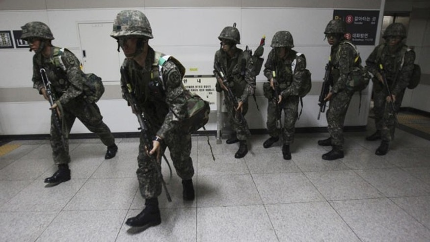 "August 19, 2013: South Korean army soldiers take part in South Korea-U.S. joint military exercise, ""Ulchi Focus Lens,"" at a subway station in Seoul. (AP Photo)"