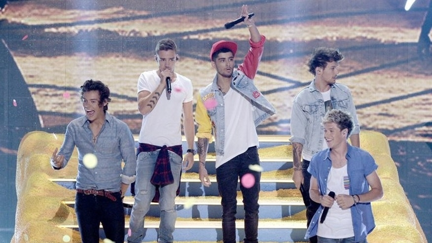 One Direction perform at the Teen Choice Awards 2013 at Gibson Amphitheatre on August 11, 2013 in Universal City, California. Fans of the British boyband are expected to bring central London to a standstill as the group launch their first film with a glitzy red carpet premiere.