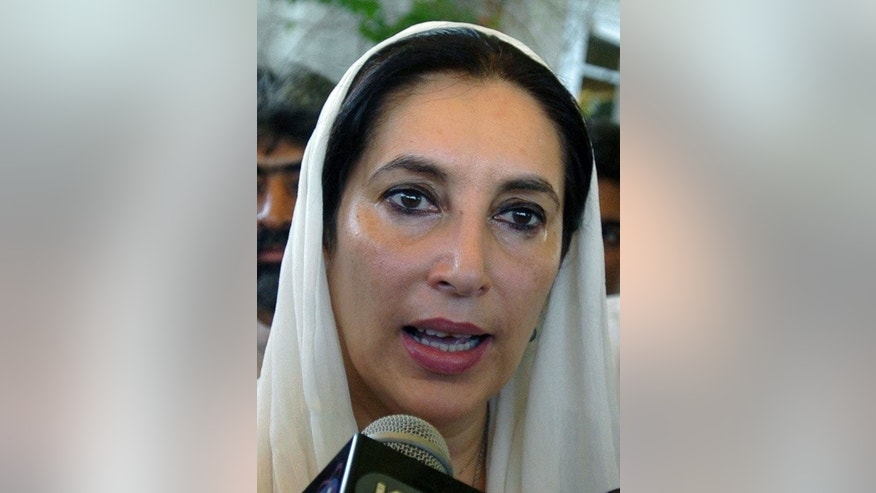 Pakistani former premier Benazir Bhutto talks to the media on November 22, 2007. Pakistan's ex-military ruler Pervez Musharraf was Tuesday charged with her murder in a suicide and bomb attack.