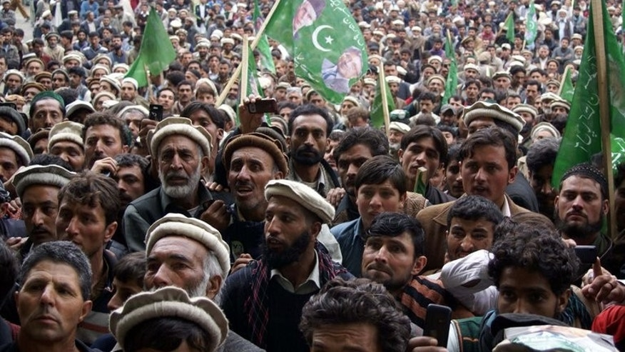 Supporters of Pervez Musharraf take part in a rally in northwestern Chitral valley on April 30, 2013. Musharraf's lawyers have dismissed his indictment for the murder of Benazir Bhutto.