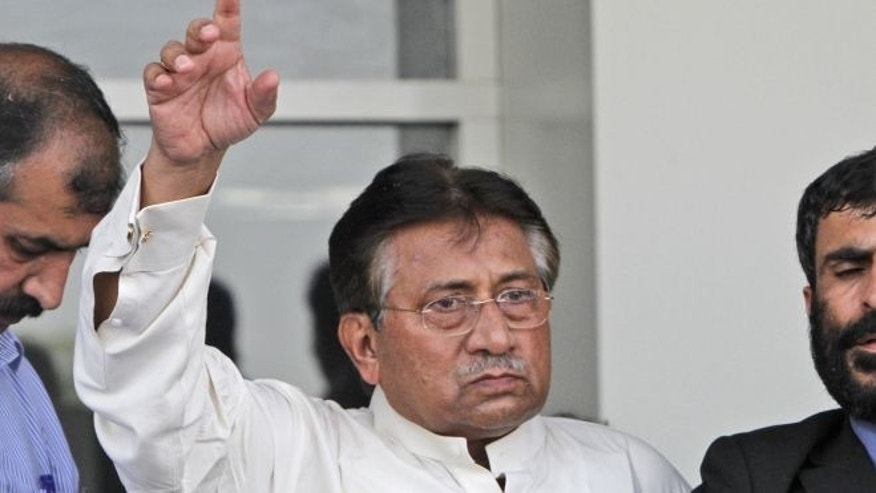 March 24, 2013: Former Pakistani President Pervez Musharraf, gestures upon his arrival to Karachi airport, Pakista.