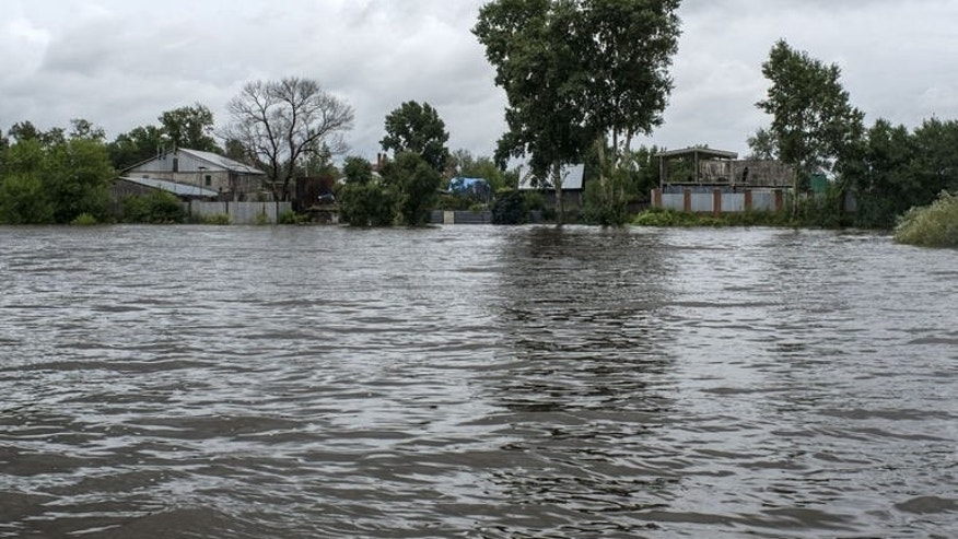 This picture taken on August 19, 2013 shows a general view of the flooded village of Bolshoi Ussuriysky island close to city of the Khabarovsk in Russia's Far Eastern Amur region.